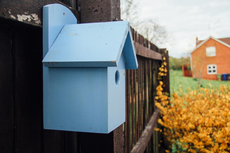 Pastel blue birdhouse